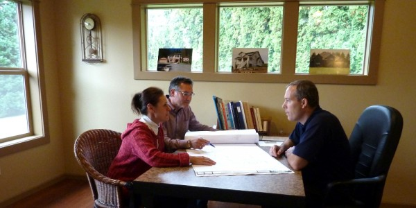 People discussing a new home plan and remodel.